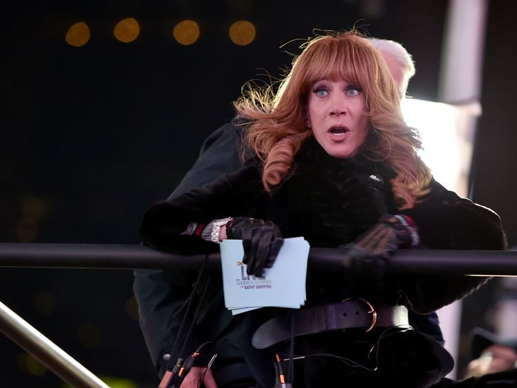 NEW YORK, NY - DECEMBER 31: Kathy Griffin Yells at Ryan Seacrest from the media riser while Anderson Cooper restrains her during New Year's Eve 2017 in Times Square at Times Square on December 31, 2016 in New York City. (Photo by Theo Wargo/Getty Images)