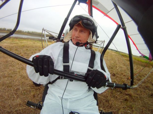 Vladimir Putin pilots a motorised hang glider