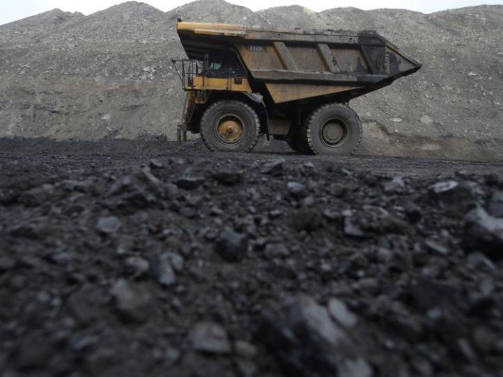 Dump trucks haul coal and sediment at the Black Butte coal mine outside Rock Springs, Wyoming, U.S.