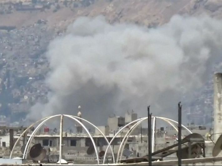 Smoke rises above the city after the aistrike