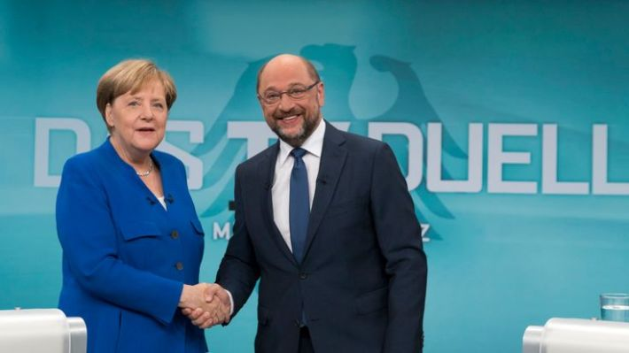 BERLIN, GERMANY - SEPTEMBER 3: In this handout picture provided by German television channel ARD, German Chancellor and Christian Democrat (CDU) Angela Merkel and German Social Democrat (SPD) and chancellor candidate Martin Schulz shake hands prior to a televised debate at ARD television studios on September 3, 2017 in Berlin, Germany.