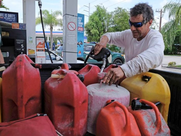 Robert Johnson fills gas containers at a gas station in Miami, Florida on September 8, 2017, ahead of Hurricane Irma. Florida Governor Rick Scott warned that all of the state's 20 million inhabitants should be prepared to evacuate as Hurricane Irma bears down for a direct hit on the southern US state. / AFP PHOTO / Gaston De Cardenas (Photo credit should read GASTON DE CARDENAS/AFP/Getty Images)