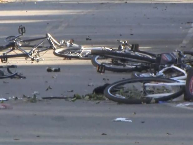 Scene along bicycle path in New York after a vehicle drove through cyclists