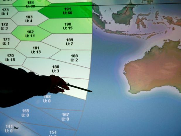 A member of staff at Inmarsat in front of a screen showing the southern Indian Ocean to the west of Australia