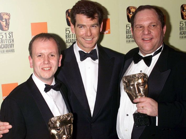 Harvey Weinstein, pictured here with David Parfitt and Pierce Brosnan (who presented the award) with his BAFTA award for Shakespeare in Love