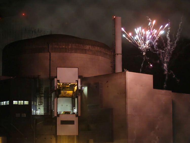 Greenpeace activists set of a firework at the nuclear plant
