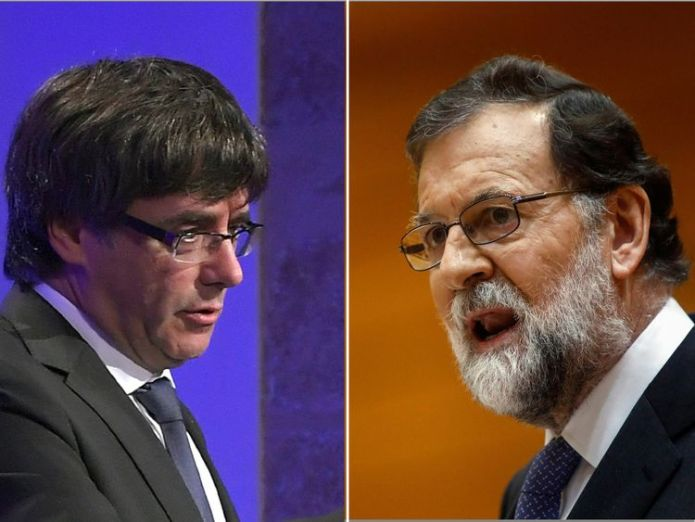 Spanish PM Mariano Rajoy (R) said Mr Puigdemont had 'generated big uncertainties'