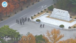 North Korean soldiers hold rifles and gather in the North Korean side of the Joint Security Area at the Demilitarized Zone North Korean 'defectors' may have been tricked North Korean 'defectors' may have been tricked skynews north korea defecting soldier shot 4162861