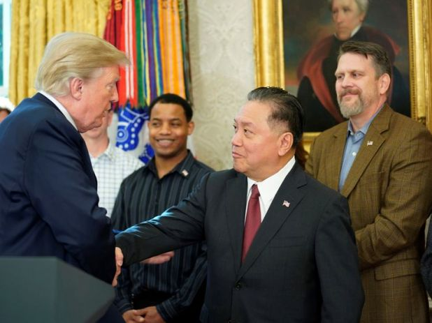 U.S. President Donald Trump shakes hands with Hock E. Tan, CEO of Broadcom