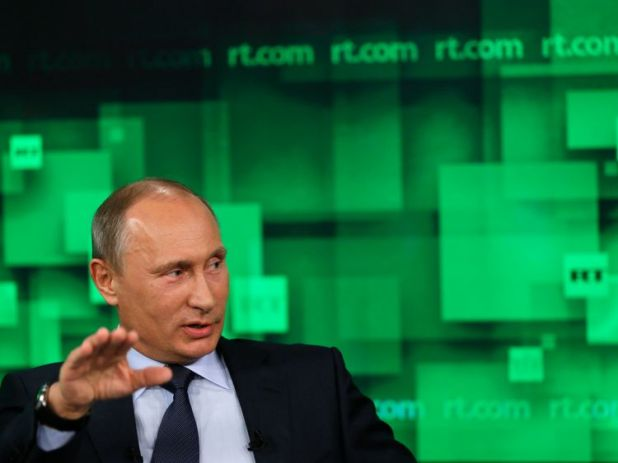 Russia's President Vladimir Putin speaks during his visit to the new studio complex of the state-owned English-language Russia Today television network in Moscow, on June 11, 2013. AFP PHOTO/ POOL/ YURI KOCHETKOV (Photo credit should read YURI KOCHETKOV/AFP/Getty Images)