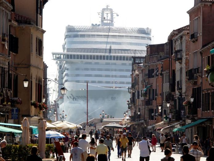 The MSC Divina cruise ship is seen in Venice lagoon, Italy June 16, 2012  Tourists face €500 fine for sitting down in Venice skynews venice divina cruise ship 4150752
