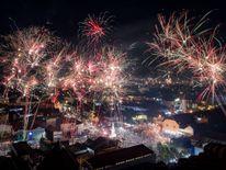 YOGYAKARTA, INDONESIA - JANUARY 01: Fireworks illuminate the city's skyline during New Year's Eve celebrations of 2018