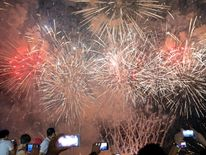 Spectators watch a fireworks display at a amusement park in Pasay, Metro Manila, in the Philippines
