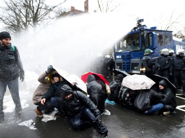 Police use water cannon to disperse protesters