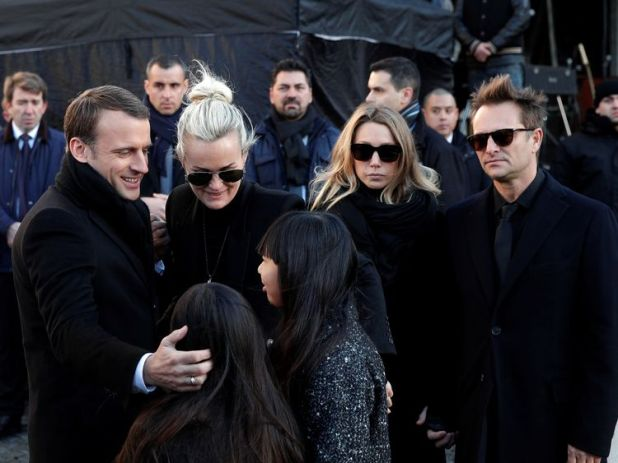 Emmanuel Macron, who was a personal friend of Hallyday's, comforted his daughters