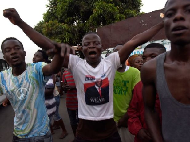 Supporters of George Weah celebrate the result