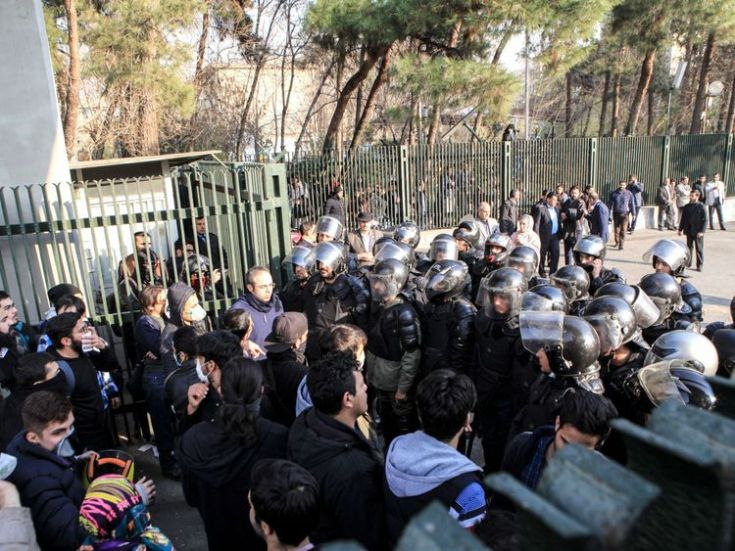 Iranian students scuffle with police at the University of Tehran