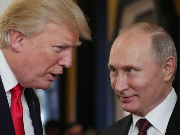 US President Donald Trump chats with Russia's President Vladimir Putin