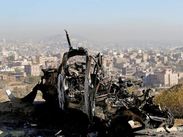 The wreckage of a vehicle at the site of air strikes in Sanaa, Yemen