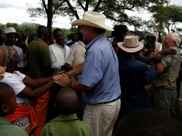 Robert are welcomed back by villagers and former workers