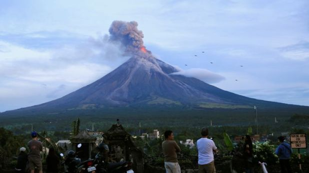 Residents watching Mount Mayon erupt on Thursday
