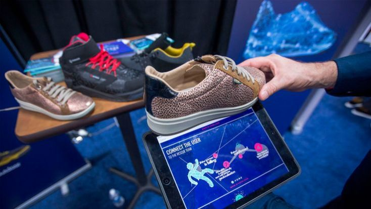 E-vone smart shoes with falling alert are displayed at CES Unveiled Las Vegas