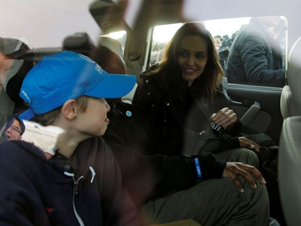 Angelina Jolie, was surrounded by children