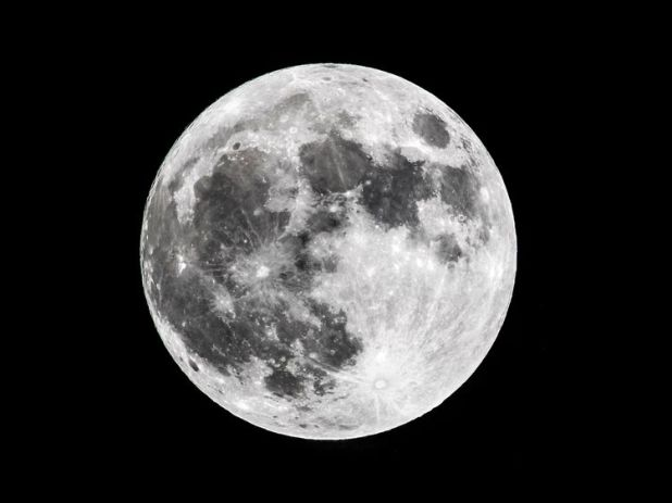 """The first supermoon of 2018, known as a 'Wolf moon' in the sky over Scarborough, North Yorkshire. PRESS ASSOCIATION Photo. Picture date: Monday January 1, 2018. Following on from the 'Cold moon' supermoon in December 2017, it will be followed by a """"super blue moon"""" on January 31 which will also coincide with a lunar eclipse. Photo credit should read: Danny Lawson/PA Wire"""