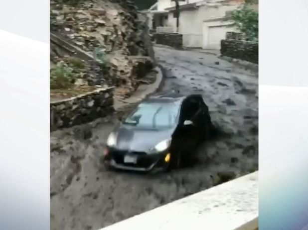 The cars is seen driving through a mudslide. Pic: Burbank Firefighters