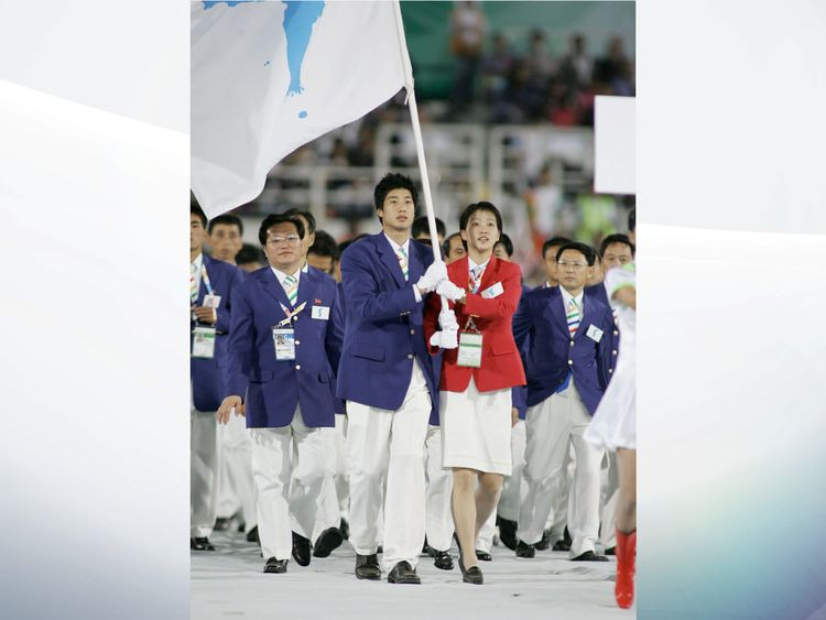 The teams march under one flag at the East Asian Games in 2005