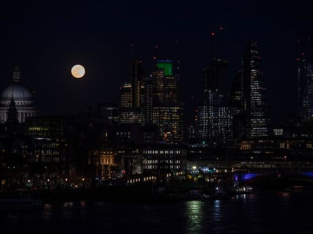 The Moon rises over St Paul's, the City and the Thames