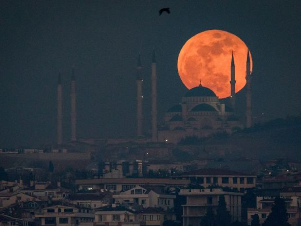 The rare Super Blue Blood Moon over Istanbul's Camlica Mosque