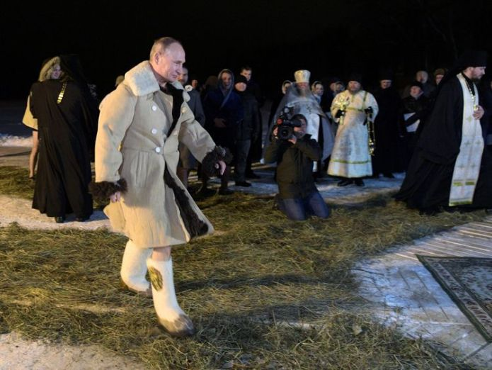 Russian President Vladimir Putin walks to take a dip in the water during Orthodox Epiphany celebrations at lake Seliger, Tver region, Russia