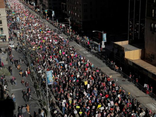 People walk down Sixth Avenue as they participate in the Women's March in Manhattan, New York City, New York, U.S., January 20, 2018. REUTERS/Andrew Kell