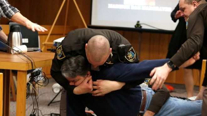 Eaton County Sheriffs restrain Randall Margraves after he lunged at Larry Nassar