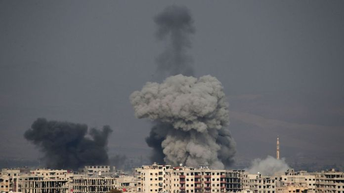 Smoke plumes rise following a regime air strike in the rebel-held town of Hamouria, in the besieged Eastern Ghouta region First day of eastern Ghouta 'truce' in Syria branded a farce First day of eastern Ghouta 'truce' in Syria branded a farce skynews syria ghouta airstrike 4236573