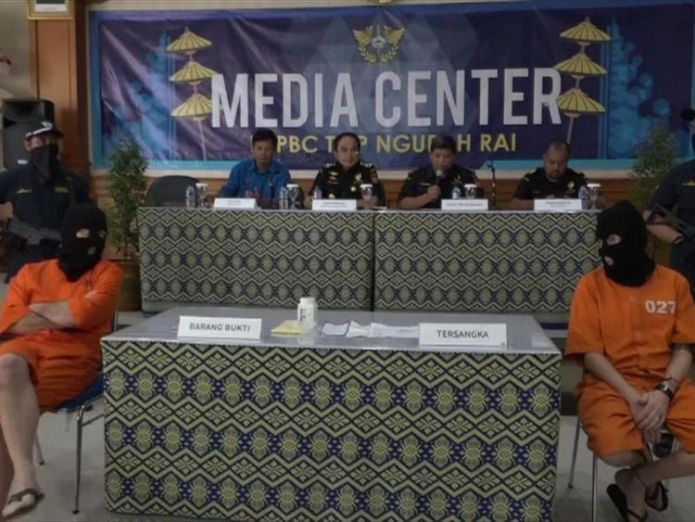 Mr Scott (right) appeared at a press conference alongside the German man Briton appears in balaclava and flanked by armed police after Bali drug arrest Briton appears in balaclava and flanked by armed police after Bali drug arrest skynews drugs bali adam scott 4237629