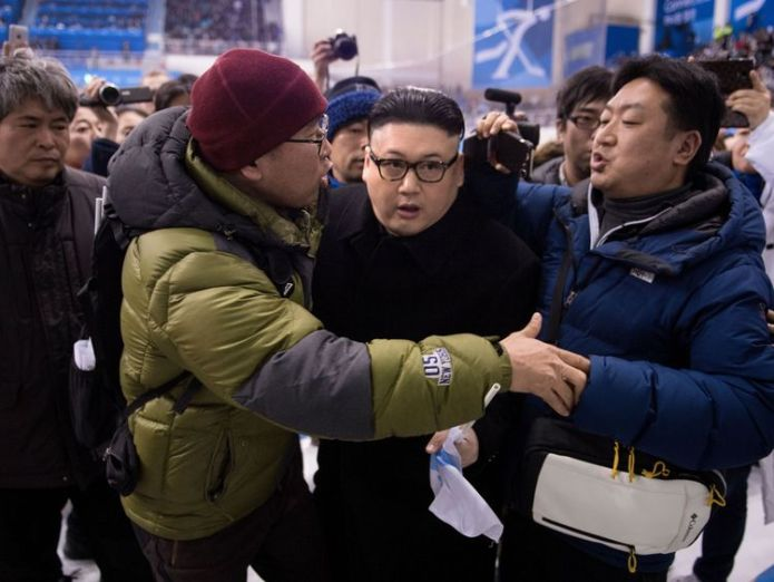 A Kim Jong Un impersonator is forced out in the final period of the women's preliminary round ice hockey match between Japan and the Unified Korean team during the Pyeongchang 2018 Winter Olympic Games at the Kwandong Hockey Centre in Gangneung on February 14, 2018.  Fake Kim Jong Un detained in Singapore and warned to stay away from Trump summit Fake Kim Jong Un detained in Singapore and warned to stay away from Trump summit skynews kim jong un north korea 4231805