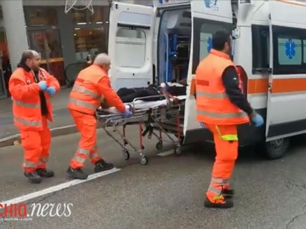 An injured person is taken in an ambulance after the shootings