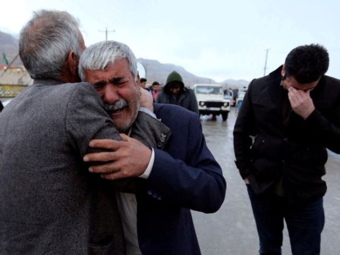 Relatives of passengers who were believed to have been killed in a plane crash react near the town of Semirom, Iran, February 18, 2018 search continues for crashed iranian plane Search continues for crashed Iranian plane skynews semirom iran plane 4235259