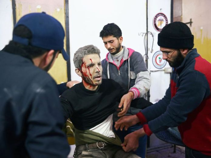 An injured man covered with blood is seen at a medical point in the besieged town of Douma, 'War crimes' claim as at least 250 killed in two days in rebel-held Syria enclave 'War crimes' claim as at least 250 killed in two days in rebel-held Syria enclave skynews syria douma world 4236557