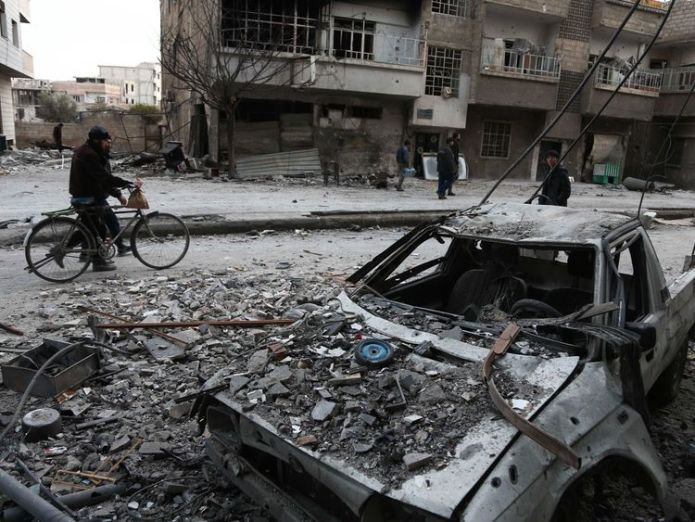 Syrians walk along a street in eastern Ghouta West 'shouldn't stand by' over Syria gas attack in eastern Ghouta West 'shouldn't stand by' over Syria gas attack in eastern Ghouta skynews syria eastern ghouta 4241738
