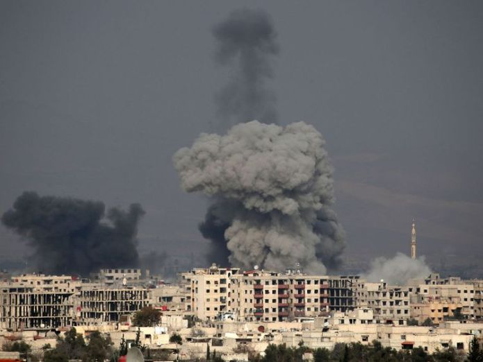 Smoke plumes rise following a regime air strike in the rebel-held town of Hamouria, in the besieged Eastern Ghouta region UN calls for end to 'hell on earth' violence in eastern Ghouta UN calls for end to 'hell on earth' violence in eastern Ghouta skynews syria ghouta airstrike 4236573
