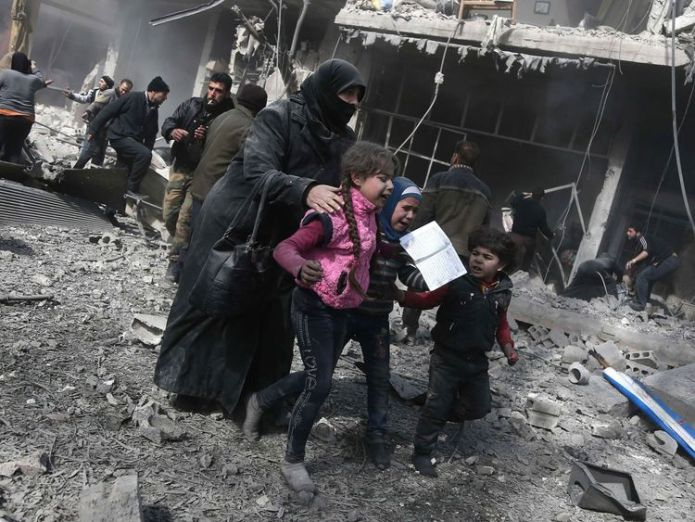 A Syrian woman and children run for cover after the air strikes Airstrikes and rocket fire 'kill 71' in Syrian rebel enclave Airstrikes and rocket fire 'kill 71' in Syrian rebel enclave skynews syria ghouta 4235352