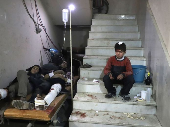A child waits to be treated at a make-shift hospital in Kafr Batna in eastern Ghouta  Syria 'massacre' goes on as UN urges ceasefire vote Syria 'massacre' goes on as UN urges ceasefire vote skynews syria ghouta 4237524