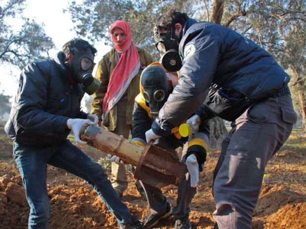 Syria: Members of the Civil defence removing the remnants of a rocket reportedly fired by regime forces on the outskirts of the rebel-held besieged Syrian town of Douma