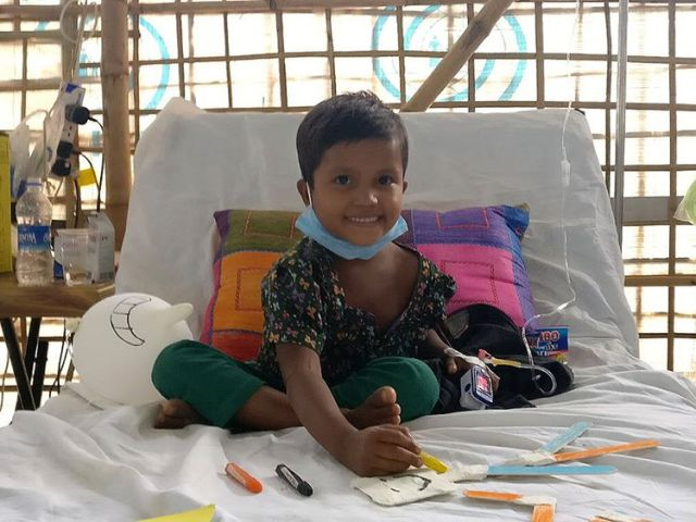 Six-year-old Sumaiya, sitting up in bed and already recovering after receiving diphtheria antitoxin treatment
