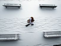 A woman walks past snow covered benches in a park in Lausanne, Switzerland Ireland on red alert as 'extraordinary' storm approaches Ireland on red alert as 'extraordinary' storm approaches skynews europe snow switzerland 4243793