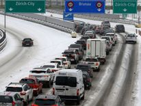 Traffic stacks up on the snow-covered A3 motorway near Zurich, Switzerland Ireland on red alert as 'extraordinary' storm approaches Ireland on red alert as 'extraordinary' storm approaches skynews europe snow switzerland 4243797