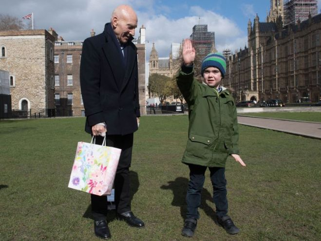 Six-year-old  with Sir Patrick Stewart in Westminster, London